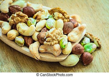 Varieties of nuts: cashew, pistachio, almond. - Healthy...