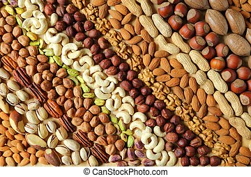 Varieties of nuts. - Natural background made from different...
