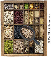 variety of beans and in vintage typesetter box with scoop - ...