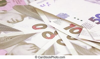 Variety of bills Ukrainian hryvnia - On the rotating surface...