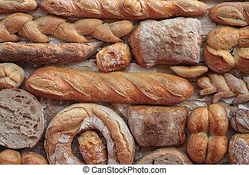 Variety of bread - Variety of fresh yummy bread resting on...