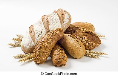 Variety of brown bread and rolls - studio