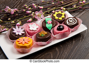 variety of cassate sicily dessert with spring flower on wood