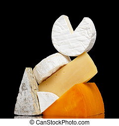 Variety of cheese isolated on black