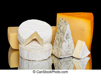 Variety of cheese isolated on black with reflection