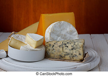 Variety of cheese on wooden table