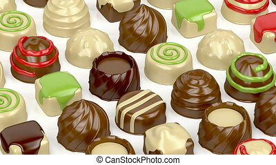 Variety of chocolate candies on white background