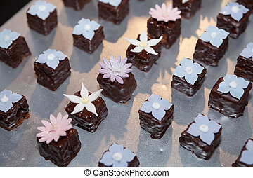Variety of chocolate cookies with flower decorations