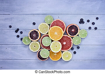 Variety of Citrus Fruits and Blueberries