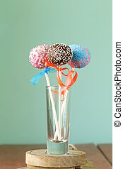 Variety of colorful cake pops - chocolate, vanilla and...