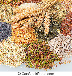 Variety of edible seeds with ears of wheat - Variety of...
