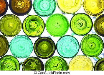 variety of empty wine bottles backlited