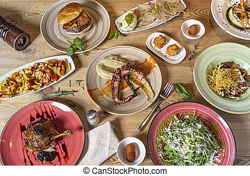 Variety of fish and meat meals. Buffet top view with a variety of food. Buffet, banquet, appetizer, restaurant menu concept.