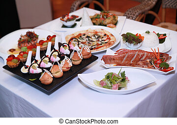 variety of food from main course salad and dessert