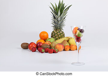 Variety of fresh fruit and a glass