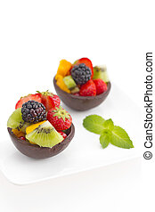 Variety of fresh fruit and berries a in chocolate home made bowls