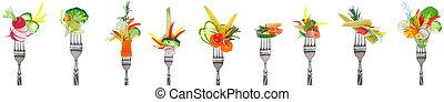 Variety of fresh vegetables on forks - white background