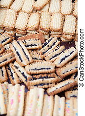 Variety of freshly baked cookies cooling off