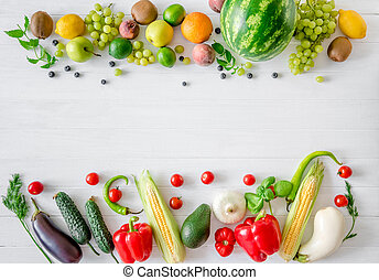 variety of fruits and vegetables on a white wooden background
