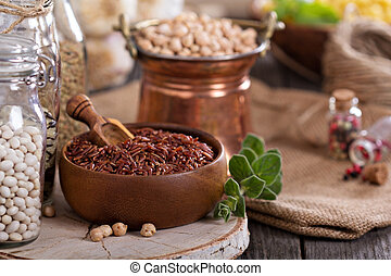 Variety of grains and beans on a wooden table