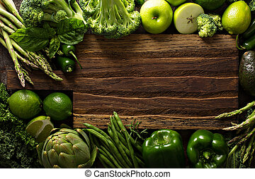 Variety of green vegetables and fruits copyspace with...