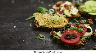 Variety of healthy fresh sandwiches with different ...