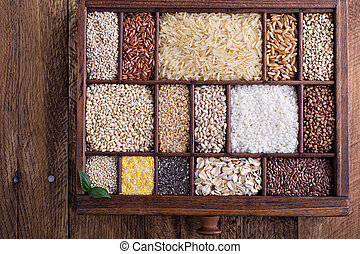 Variety of healthy grains and seeds in a wooden box