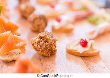 Variety of Hors D'oeuvres on a wooden platter