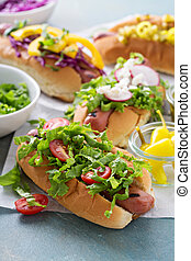 Variety of hot dogs with healthy garnishes