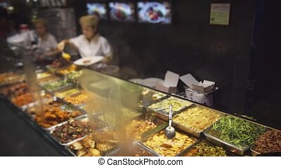 Variety of Hot Foods at a Chinese Eatery in Singapore -...