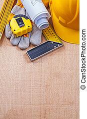 Variety of house improvement objects on oak wooden board constru