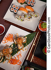 Variety of Japanese food dishes on the wooden table. Vertical picture