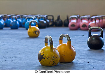 Variety of kettlebells in gym