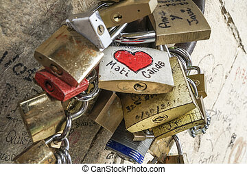 love symbol padlocks hanged on wall