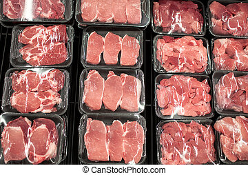 Variety of meat slices in boxes in supermarket