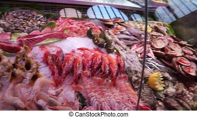 variety of Mediterranean seafood on counter spanish market.