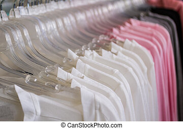 Variety of multicolored shirt clothes hangers.