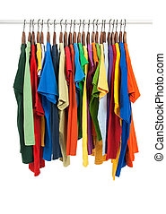 Variety of multicolored shirts on wooden hangers
