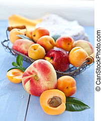 Variety of peaches in a vintage basket