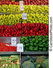 Variety of peppers for sale at an open-air market
