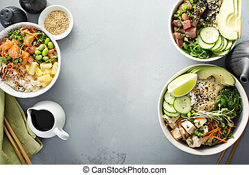 Variety of poke bowls with tuna, salmon and tofu on rice...