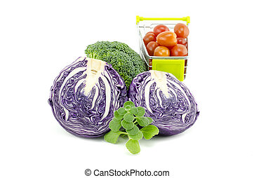 variety of raw vegetables. purple cabbage, cherry tomatoes on trolley, green mint and broccoli isolated white background