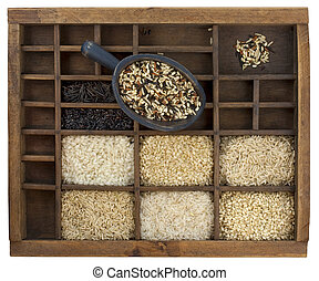 variety of rice grains in vintage wooden drawer with scoop...