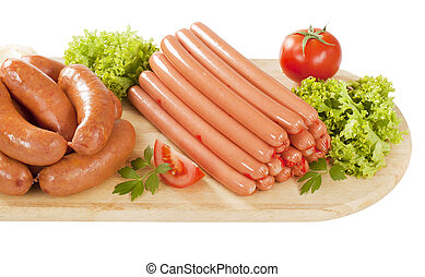 variety of sausages on wooden cutting board