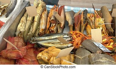 Variety of sea fishes on the counter in a fish shop. -...