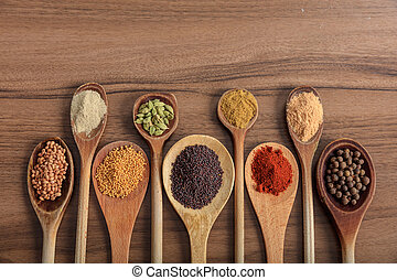Variety of spices on a wooden surface - Variety of colorful...