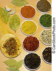 variety of spices on the wooden board