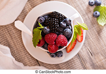 Variety of summer berries in a cup