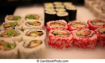 Variety of sushi on shelves in supermarket In Japan. Close up Of macro with blurred background and bokeh.