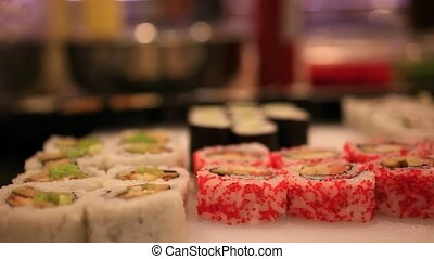 Variety of sushi on shelves in supermarket In Japan. Close up Of macro with blurred background and bokeh. HD. 1920x1080